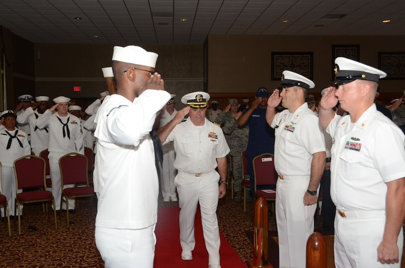 "Navy Capt. Timothy Sparks is ""piped aboard"" to begin the Naval Support Activity change of command July 1, 2013, at the Redbank Club at Joint Base Charleston — Weapons Station. Sparks relieved Capt. Thomas Bailey. (U.S. Navy photo/ Petty Officer 1st Class Chad Hallford)"