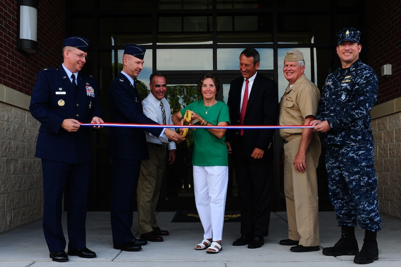 (From left to right) Lt. Col. Aaron Altwies, 628th Civil Engineer Squadron commander, Col. Justin Davey, 628th Mission  Support Group commander, Erich Reichle, Project Manager and Sauer representative, Judy Anderson, 628th CES employee, Congressman Mark Sanford, Capt. Thomas Bailey, Joint Base Charleston deputy commander, and Lt. Cmdr. Ancelmo McCarthy, Resident Officer in Charge of Construction, cuts a ribbon during the official 628th Civil Engineering complex ribbon cutting on July 8, 2013, at Joint Base Charleston – Air Base, S.C. There was a guest appearance by Congressman Mark Sanford. The new CE building is 48,000 square feet and provides consolidation for a 462 person unit that constructs and maintains daily base operations. (U.S. Air Force photo/ Airman 1st Class Chacarra Neal)