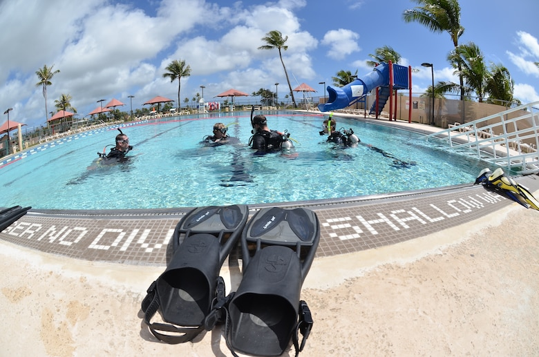David Jenkins, 36th Force Support Squadron Andersen Family Dive Center instructor, teaches basic scuba skills during an open-water class at the pool on Andersen Air Force Base, Guam, June 22, 2013. Pool dives are an essential part of learning basic skills to prepare divers for the ocean. (U.S. Air Force photo by Staff Sgt. Veronica Montes/Released)