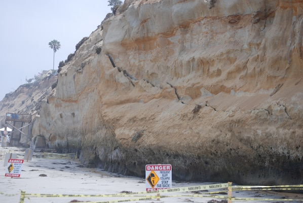 A jagged crack near the base of a bluff at Encinitas, Calif., is an early indication that the bluff will fail. A Corps study for Encinitas and nearby Solana Beach proposes restoration efforts to protect the shoreline, making circumstances such as this less likely.