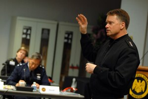 """Navy Adm. James """"Sandy"""" Winnefeld, commander of U.S. Northern Command, speaks to senior Guard officers and enlisted leaders during the 2011 General Senior Leadership Conference at Arlington Hall in Arlington, Va., Feb. 28, 2011. Winnefeld talked with the adjutant generals about the contingency dual-status commander concept, which would create better cooperation between federal and state assets during a disaster."""
