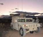 Pfc. Ronnie Thompson, an Air and Missile Defense Crewmember, conducts a systems check of an Avenger weapon system. The Avenger system was used in conjunction with Sentinel radars to detect aircraft attempting to illegally enter U.S. airspace along the U.S. – Mexico border in Arizona.