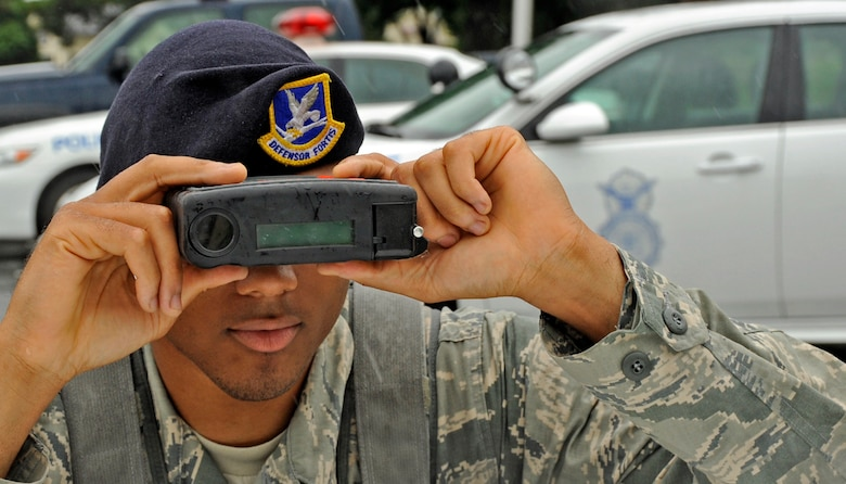 U.S. Air Force Airman 1st Class Adrian Isom, 35th Security Forces Squadron basic force protection, simulates using a Lidar to measure how fast cars are going at Misawa Air Base, Japan, July 11, 2013. If caught speeding the police take points from your license as a penalty. 33 kilometers per hour -and over the speed limit you lose 6 points and get your license revoked for a year. (U.S. Air Force photo by Airman 1st Class Kenna Jackson)