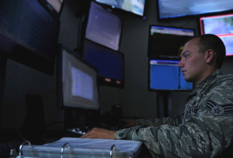 Senior Airman Zachary Johnston, 51st Security Forces Squadron tactical automated security system operator, monitors the base alarms and surveillance systems in the Combined Defense Operations Center on Osan Air Base, Republic of Korea, June 27, 2013. CDOC monitors more than 180 cameras on base, safeguarding $54 billion of assets on Osan. (U.S. Air Force photo/Senior Airman Kristina Overton)