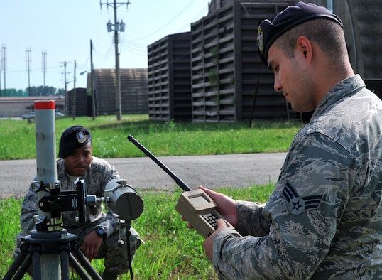 Senior Airman Eric Salazar checks readings on a handheld monitor while Airman 1st Class Taali Ruffin blocks the alignment of the transmitter to the receiver of a passive infrared sensor during a regular maintenance inspection on Osan Air Base, Republic of Korea, June 27, 2013. Both Salazar and Ruffin are tactical automated security system administrators with the 51st Security Forces Squadron. (U.S. Air Force photo/Senior Airman Kristina Overton)