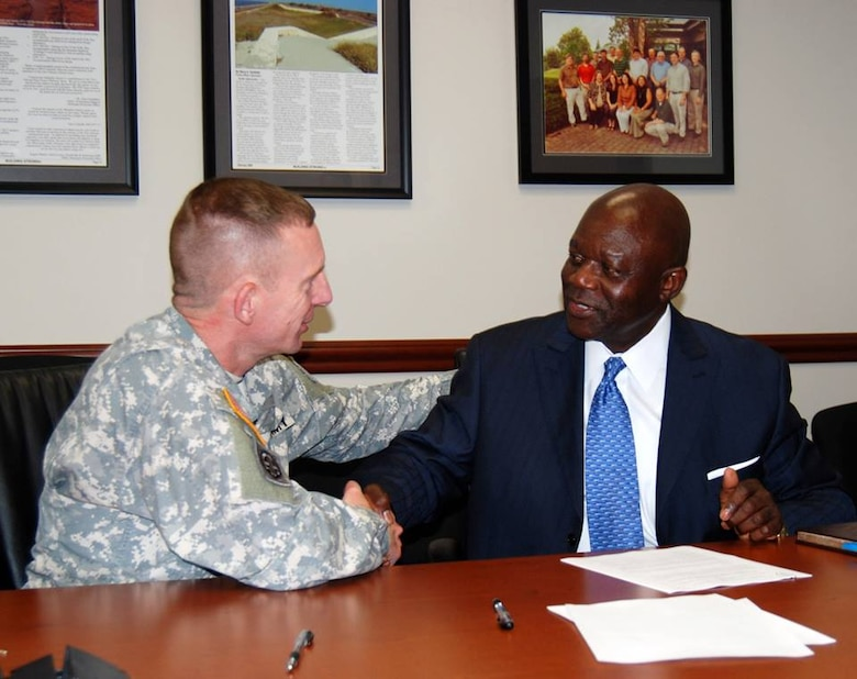 July 9, 2013: Memphis District Commander Col. Vernie Reichling (left) and International Federation of Professional and Technical Engineers (IFPTE) Local 259 President Melvin Tate (right) signed a Labor Forum Agreement today at the District Headquarters. In the works for more than a year, the agreement between IFPTE and the Memphis District will establish and maintain a cooperative, constructive working relationship which will provide a better quality of work life for employees, more efficient administration of District programs, and above all, better service for the District's customers. The forum will meet quarterly and will include IFPTE bargaining unit employees and District management.