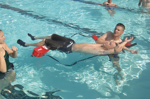 Capt. Justin Cooper, company commander, Marine Corps Logistics Base Albany, practices rescuing a simulated unresponsive victim, Sgt. Nathan Phelps, telephone management, Computer Information Systems Division, MCLB Albany, during lifeguard certification training here, recently.