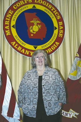 Janice Holt, financial technician, Civilian Payroll Liaison Office, Office of the Comptroller, Marine Corps Logistics Base Albany, retires June 26 during a ceremony held in the Carson Conference Room, here.