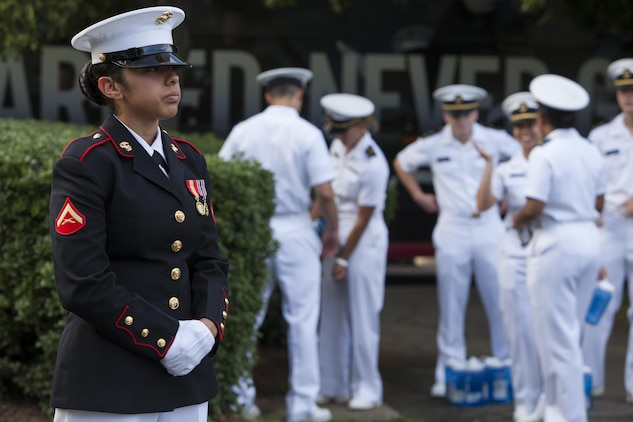 Lance Cpl. Daniela Gonzalez, a ceremonial hoster with Marine Barracks Washington, D.C., stands her post prior to the commencement of a Tuesday Sunset Parade at the Marine Corps War Memorial in Arlington, Va., June 11.
