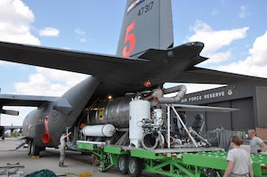 A U.S. Forest Service Modular Airborne Fire Fighting System II (MAFFS II) unit is loaded on to an Air Force Reserve Command C-130 Sept. 9 at Peterson Air Force Base, Colo. in preparation for support of aerial firefighting missions in Texas. Four Air Reserve Component MAFFS-equipped C-130s and crews have been tasked by U.S. Northern Command in support of the National Interagency Fire Center to supplement wildland firefighting efforts in Texas. Two C-130s from the 302nd Airlift Wing, stationed at Peterson AFB, Colo. and two C-130s from the 145th Airlift Wing of the North Carolina Air National Guard will deploy to Austin, Texas.