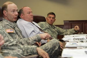 Gen. Charles Jacoby, Jr. (left), commanding general, North American Aerospace Defense Command and U.S. Northern Command, Robert Fenton Jr. (center), assistant administrator, Federal Emergency Management Agency, and Lt. Gen. William Caldwell IV, commanding general, U.S. Army North (Fifty Army) discuss the importance of preparation for any eventuality during the Complex Catastrophe Tabletop Exercise held June 5 at Army North in the historic Quadrangle.