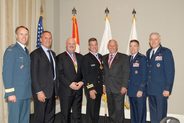 The NORAD and U.S. Northern Command Missile Warning and Defenders of the Year were awarded in a formal ceremony May 3 in Colorado Springs. The event honored top-performing military and civilan personnel at the headquarters who perform work on or in support of missile defense systems. Pictured, from left to right, are Canadian Brig.- Gen. Al Meinzinger, Riki Ellison of the Missile Defense Advocacy Alliance, Steven Piel, Navy Lt. Cmdr. Douglas Pegher, Ernie Stern, Air Force Lt. Gen. Michael Dubie, and Air Force Brig. Gen. Kenneth Todorov.