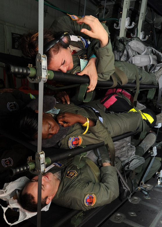 Aeromedical evacuation technicians with the 43rd AES play patient during a training flight on a Royal Canadian Air Force C-130J medium transport aircraft at Pope Field, N.C., on July 12, 2013.  During the flight, members of the 43rd AES and 36th AES were shadowed by personnel from the RCAF 426 Squadron Medical Flight while taking part in a two-day training mission intended to enhance inter-service partnership and provide continuation training.  (Air Force Photo by Tech. Sgt. Peter R. Miller)