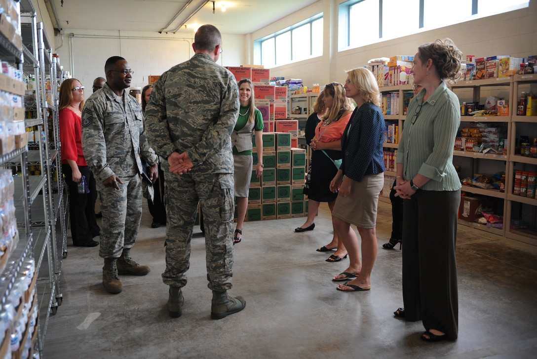 Athena Cody, spouse of Chief Master Sgt. of the Air Force James Cody, tours the first sergeants pantry at Minot Air Force Base, N.D., July 12, 2013. The first sergeants pantry is a base initiative to get food supplies to families most in need. The group sponsors a yearly turkey give away on thanks giving as well as partnering with a variety of other charitable organizations. (U.S. Air Force photo/ Airman 1st Class Stephanie Ashley)