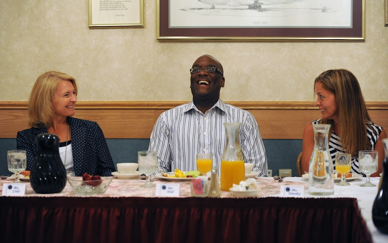 Athena Cody, spouse of Chief Master Sgt. of the Air Force, James Cody enjoys a meal with the Key Spouses and Enlisted Spouses groups at Minot Air Force Base, N.D., July 12, 2013. Mrs. Cody toured a variety of base facilities during her visit and took note of the issues faced by spouses and their families on a daily basis. (U.S. Air Force photo/ Airman 1st Class Stephanie Ashley)