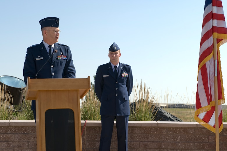 Col. Michael Kindt, 460th Medial Group commander, addresses members of the 460th MDG July 11, 2013, on Buckley Air Force Base, Colo. Kindt will command a group that supports world-wide contingency operations with space operations components and delivers medical support for 3,600 active-duty and 3,400 family members. (U.S. Air Force photo by Senior Airman Phillip Houk/Released)