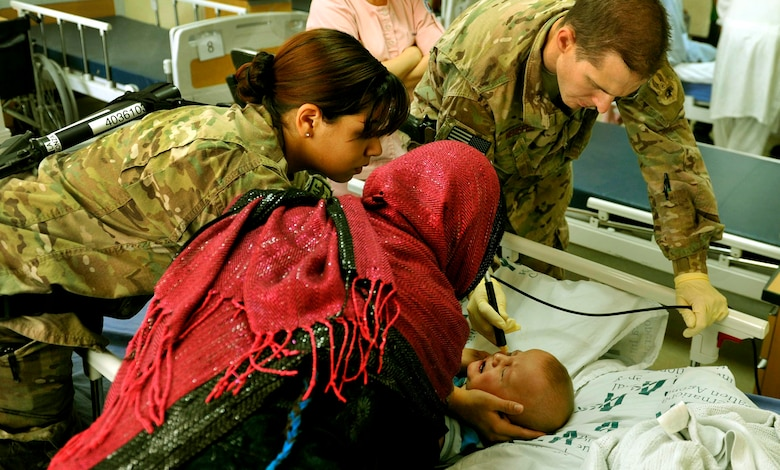 Maj. Marcus Neuffer, an ophthalmologist, and his technician Airman 1st Class Chellbie Gonzales conduct an ultrasound on the left eye of a 12-month-old boy July 7, 2013, in the Korean hospital at Bagram Airfield, Afghanistan. Neuffer is currently the only doctor at Bagram who is qualified to operate on eyes. Neuffer and Gonzales are with the 455th Expeditionary Medical Group. (U.S. Air Force photo/Staff Sgt. Stephenie Wade)