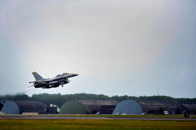 An F-16 Fighting Falcon from the 14th Fighter Squadron takes off from Misawa Air Base, Japan, June 28, 2013. Pilots from the 35th Fighter Wing flew to Draughon Range to practice attacking ground targets. The 1,900-acre range is used continuously by both United States Air Force and Japanese Air Defense Force pilots for bombing and gunnery proficiency and qualification. (U.S. Air Force photo/Staff Sgt. Nathan Lipscomb)