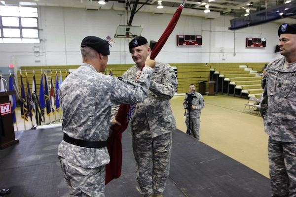Brig. Gen. Richard L. Stevens (left), Commander, U.S. Army Corps of Engineers, Pacific Ocean Division, passes the Engineer Colors to Col. Bryan S. Green (right), Far East District incoming commander, during a ceremony on U.S. Armcy Garrison Yongsan July 11.