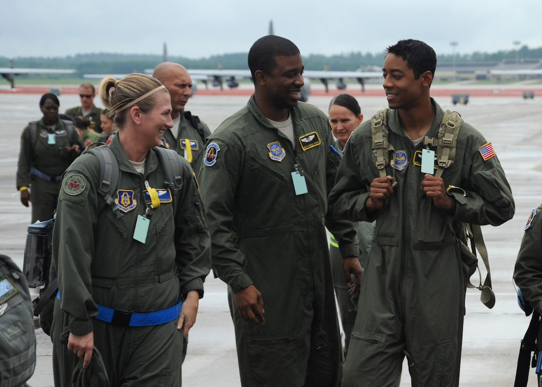 Members of the 36th and 43rd Aeromedical Evacuation Squadrons walk on the flight line at Pope Field, N.C., on July 12, 2013.  The 36th AES is an Air Force Reserve squadron that is collocated with the active-duty 43rd AES at Pope Field, N.C.  (U.S. Air Force photo by Tech. Sgt. Peter R. Miller)