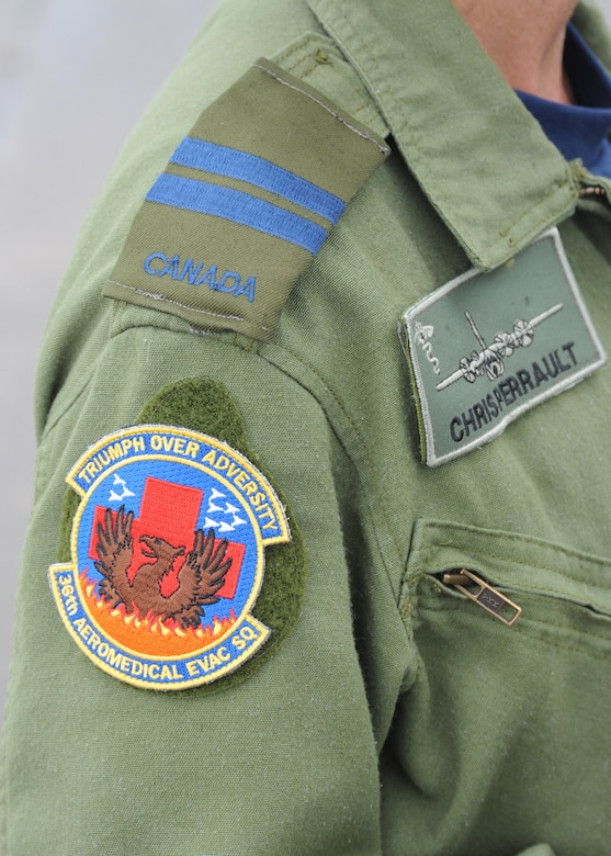 A member of the Royal Canadian Air Force wears a 36th Aeromedical Evacuation Squadron unit patch during a training mission at Pope Field, N.C., on July 12, 2013.  Military members commonly trade memorabilia including unit patches, challenge coins and flags during joint-force missions.  (U.S. Air Force photo by Tech. Sgt. Peter R. Miller)
