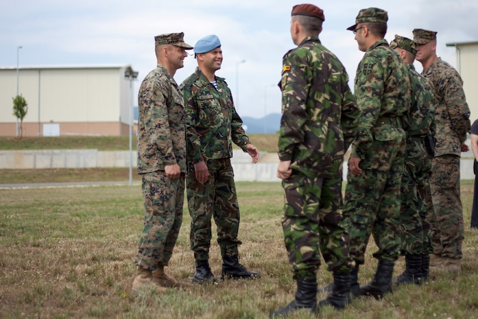 Lt. Col. Steven M. Wolf, left, commander of Black Sea Rotational Force 13, and Bulgarian Army Colonel Iavor Mateev, right, officer-in-charge of Bulgarian forces participating in BSRF-13, speak with Bulgarian, Serbian, Romanian and American company commanders at Novo Selo, Bulgaria, following an opening ceremony July, 1, 2013. The opening ceremony marked the beginning of Platinum Lion 13, BSRF-13's five week exercise in Bulgaria. The exercise allows the U.S. and Balkan military forces to practice stability, counterinsurgency, and peacekeeping operations in order to build partner nation capacity, enhance interoperability between countries and increase the overall effectiveness of the participating partnered nations. (U.S. Marine Corps photo by 1st Lt. Hector Alejandro)