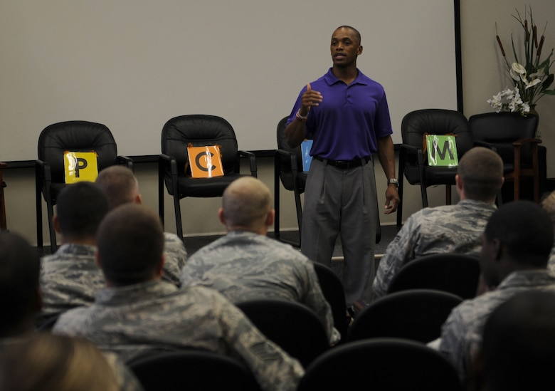 "Leonard Wheeler, a former National Football League player and ""game on"" presenter, makes a point to Hurlburt Airmen during a ""game on"" presentation at the Vincent Airman Leadership School auditorium at Hurlburt Field, Fla., July 11, 2013. Wheeler guided the audience of more than 50 Air Commandos through exercises about communication and leadership. (U.S. Air Force Photo / Senior Airman Joe McFadden)"
