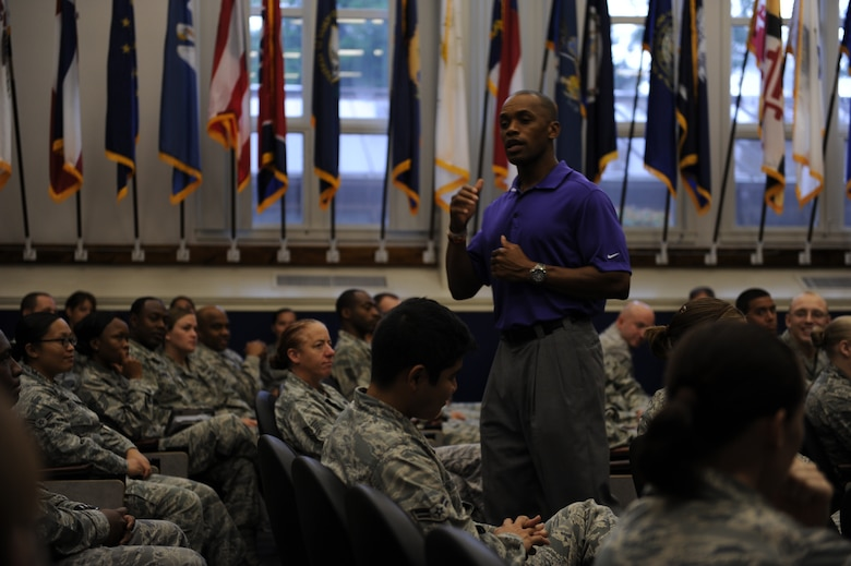 "Leonard Wheeler, a former National Football League player and ""game on"" presenter, makes a point to Hurlburt Airmen during a ""game on"" presentation at the Vincent Airman Leadership School auditorium at Hurlburt Field, Fla., July 11, 2013. ""Game on"" is a nationwide presentation dedicated to enhancing communication skills among its audiences. (U.S. Air Force Photo / Senior Airman Joe McFadden)"