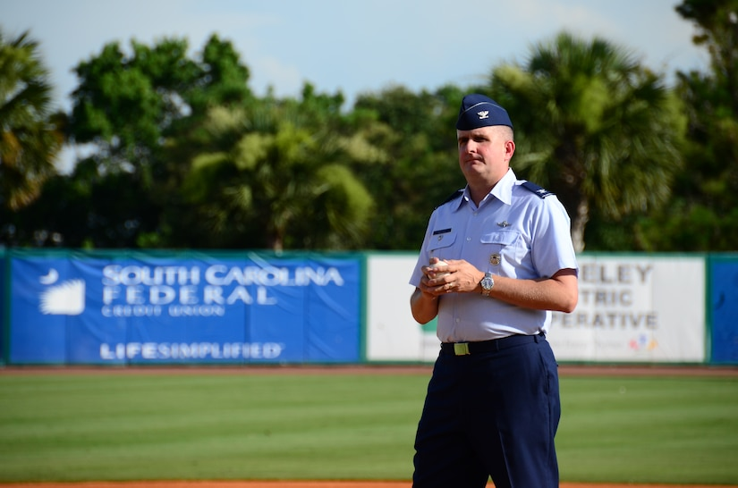 Col. Al Miller, 437th Airlift Wing vice commander, prepares to deliver the ceremonial first pitch during Military Appreciation Night July 13, 2013, at the Joseph P. Riley Jr. ballpark in Charleston, S.C. The Charleston RiverDogs hosted Military Appreciation Night to show their support for the local military. (U.S. Air Force photo/ Staff Sgt. Anthony Hyatt)