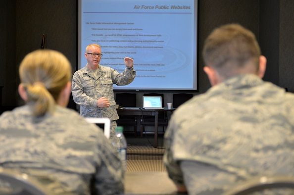 MCGHEE TYSON AIR NATIONAL GUARD BASE, Tenn. – Master Sgt. Bill Conner, a public affairs training manager at the I.G. Brown Training and Education Center, speaks with Air National Guard public affairs personnel here July 12, 2013, about the Air Force Public Information Management System during the TEC's Public Affairs Managers Course. (U.S. Air National Guard photo by Master Sgt. Kurt Skoglund/Released)