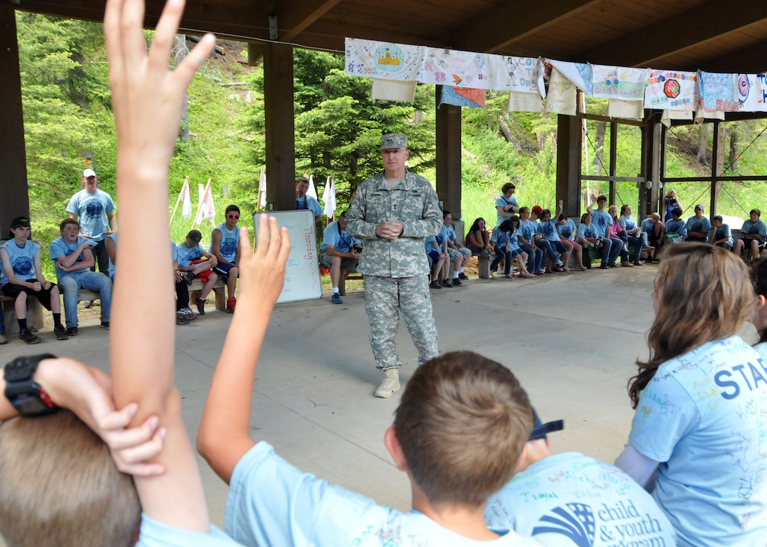 Montana National Guard Adjutant General, Maj. Gen. Matthew Quinn, answers questions posed to him from young campers during Camp Runnamucka, held at Camp Rotary located near Monarch, Mont. on June 27, 2013. (Air Force photo/Senior Master Sgt. Eric Peterson)