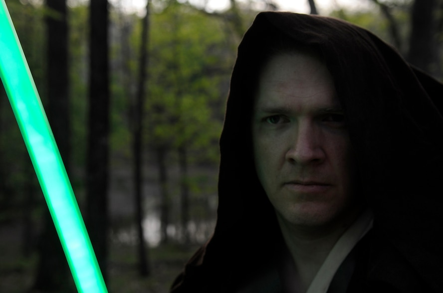 """Master Sgt. Kenneth Hampton, 509th Medical Group NCO-in-charge of education and training, crafts custom light sabers in his spare time, May 7, 2013. He was inspired to create lightsabers after watching """"Star Wars"""" for the first time when he was 7 years old. (U.S. Air Force photo by Staff Sgt. Alexandra M. Boutte/Released)"""
