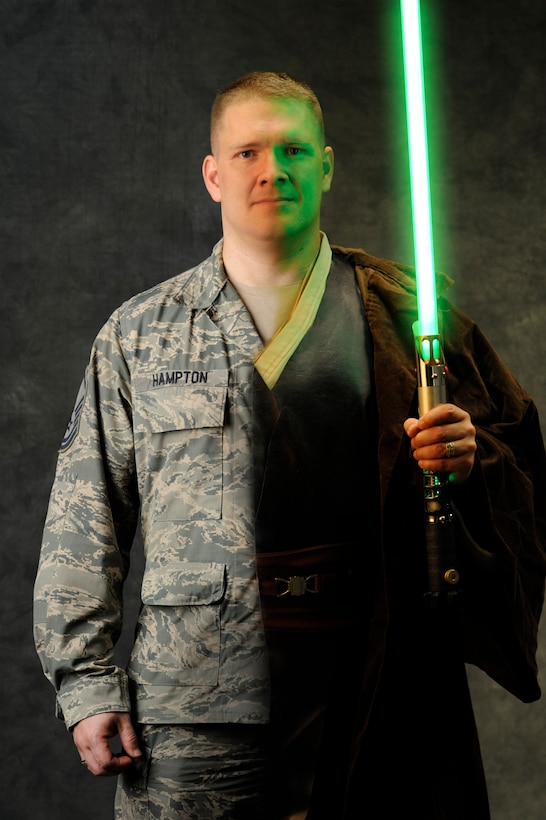 """Master Sgt. Kenneth Hampton, 509th Medical Group NCO-in-charge of education and training, crafts custom light sabers in his spare time, July 2, 2013. Inspired by """"Star Wars,"""" Hampton started building his own lightsaber, 'Transparency,' in February 2013.  (U.S. Air Force photo illustration by Staff Sgt. Alexandra M. Boutte/Released)"""