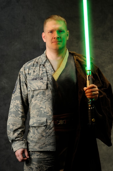 "Master Sgt. Kenneth Hampton, 509th Medical Group NCO-in-charge of education and training, crafts custom light sabers in his spare time, July 2, 2013. Inspired by ""Star Wars,"" Hampton started building his own lightsaber, 'Transparency,' in February 2013.  (U.S. Air Force photo illustration by Staff Sgt. Alexandra M. Boutte/Released)"