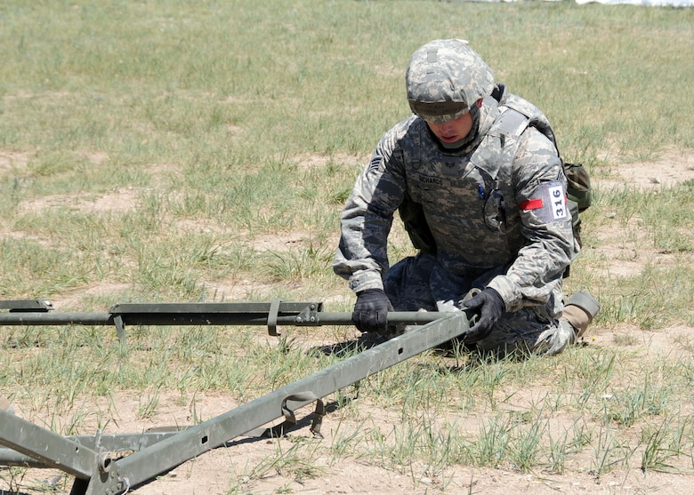 Senior Airman Josiah Richards, 219th RED HORSESquadron member, erects a temper tent during a field training exercise at Fort Harrison, Mont. June 10, 2013  The squadron participated in contingency training during their unit training assembly.  (U.S. Air Force photo/2nd Lt Robin Jirovsky)