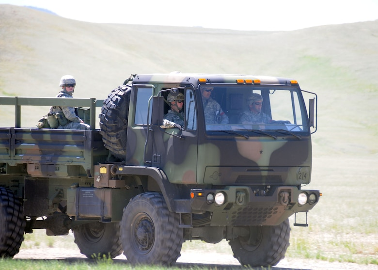 Members of the 219th RED HORSE Squadron conduct vehicle training during a field training exercise at Fort Harrison, Mont. June 10, 2013.  The squadron participated in contingency training during their unit training assembly. (U.S. Air Force photo/2nd Lt Robin Jirovsky)