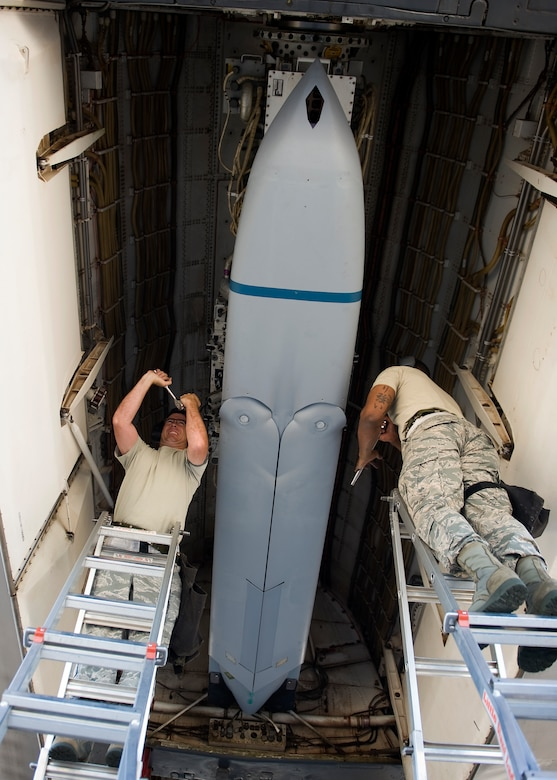 U.S. Air Force Master Sgt. Troy Drasher (left) and Tech. Sgt. Alfred Agee both from the 7th Maintenance Group load a Long Range Anti-Ship Missile (LRASM) into the bomb bay of a B-1 Bomber June 12, 2013, at Dyess Air Force Base, Texas. Unlike current anti-ship missiles the LRASM will be capable of conducting autonomous targeting, relying on on-board targeting systems to independently acquire the target without the presence of prior, precision intelligence, or supporting services like Global Positioning Satellite navigation and data-links. These capabilities will enable positive target identification, precision engagement of moving ships and establishing of initial target cueing in extremely hostile environment. (U.S. Air Force photo by Airman 1st Class Damon Kasberg/Released)