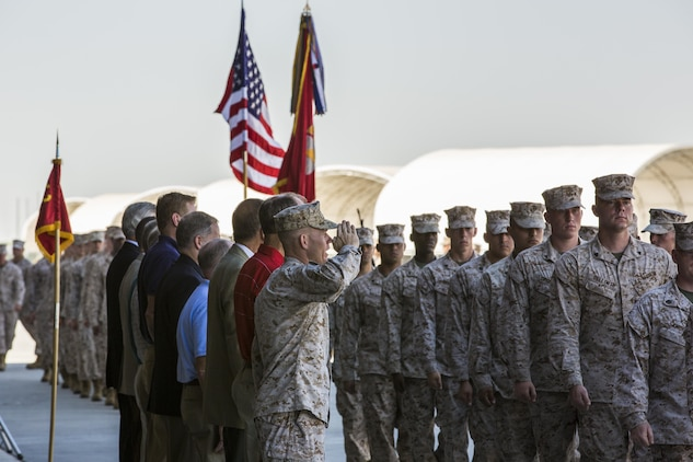 Lt. Col. Samuel Smith, the commanding officer of Marine Attack Squadron 513, flanked by past commanding officers of VMA-513, pay their respects to the Marines of the squadron as they march past during VMA-513's Deactivation Ceremony at the squadron hanger aboard Marine Corps Air Station Yuma, Ariz., July 12. These Marines are the last of the Nightmares.