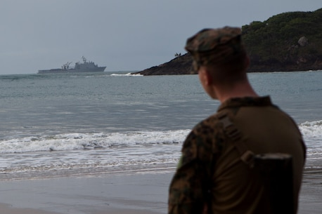 A Marine with Company G., Battalion Landing Team 2nd Battalion, 4th Marines, 31st Marine Expeditionary Unit, looks upon the USS Germantown (LSD 42) from the beach here, July 15. The Marines and Sailors of Co. G. and Combat Logistics Battalion 31, 31st MEU, are preparing to participate in exercise Talisman Saber 2013, a bilateral training exercise between the U.S. and Australian militaries, bolstering their interoperability and combat readiness as a Combined Joint Task Force. The 31st MEU is the only continuously forward-deployed MEU and is the Marine Corps' force in readiness in the Asia-Pacific region.