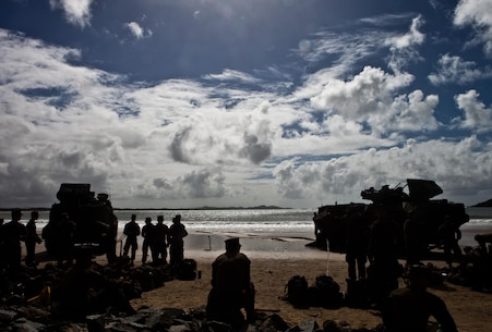 Marines and Sailors with Company G., Battalion Landing Team 2nd Battalion, 4th Marines, 31st Marine Expeditionary Unit, rest on the beach following a two-hour ride ashore in amphibious assault vehicles here, July 15. The Marines and Sailors of Co. G. and Combat Logistics Battalion 31, 31st MEU, are preparing to participate in exercise Talisman Saber 2013, a bilateral training exercise between the U.S. and Australian militaries, bolstering their interoperability and combat readiness as a Combined Joint Task Force. The 31st MEU is the only continuously forward-deployed MEU and is the Marine Corps' force in readiness in the Asia-Pacific region.