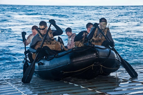Marines of the Amphibious Reconnaissance Platoon of the 31st Marine Expeditionary Unit push a combat rubber raiding craft into the ocean from the well deck ramp here, July 17. The platoon used the CRRC boats to insert multiple reconnaissance teams in support of an upcoming amphibious raid as part of exercise Talisman Saber 2013. The Marines and Sailors of the 31st MEU, PHIBRON 11, and Expeditionary Strike Group 7 are training alongside a joint U.S. force that totals approximately 18,000 personnel, as well as approximately 9,000 Australian service members in the fifth iteration of Talisman Saber, a month-long biennial exercise designed to enhance multilateral collaboration in support of future combined operations, natural disaster, humanitarian and emergency response. The 31st MEU is the Marine Corps' force in readiness for the Asia Pacific region and the only continuously forward-deployed MEU.