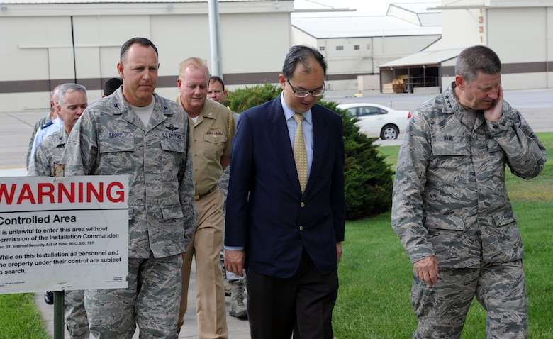 From left, U.S Air Force Col. Christopher Short, 366th Fighter Wing commander, Mr. Chiang Chie Foo, Republic of Singapore Permanent Secretary (Defence), and Lt. Gen. Robin Rand, 12th Air Force commander, walk during a tour July 15, 2013, at Mountain Home Air Force Base, Idaho. General Rand and Mr. Foo's tour included stops at the Gunfighter Club and Wing Headquarters building. (U.S. Air Force photo by Senior Airman Benjamin Sutton/ Released)