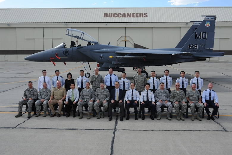 Base leadership poses for a photo with U.S Air Force Lt. Gen. Robin Rand, 12th Air Force commander, and Mr. Chiang Chie Foo, Permanent Secretary (Defence), at Mountain Home Air Force Base, Idaho, July 15, 2013. General Rand and Mr. Foo participated in a tour of the base and took time to visit different stops such as the 428th Fighter Squadron. (U.S. Air Force photo by Senior Airman Benjamin Sutton/ Released)