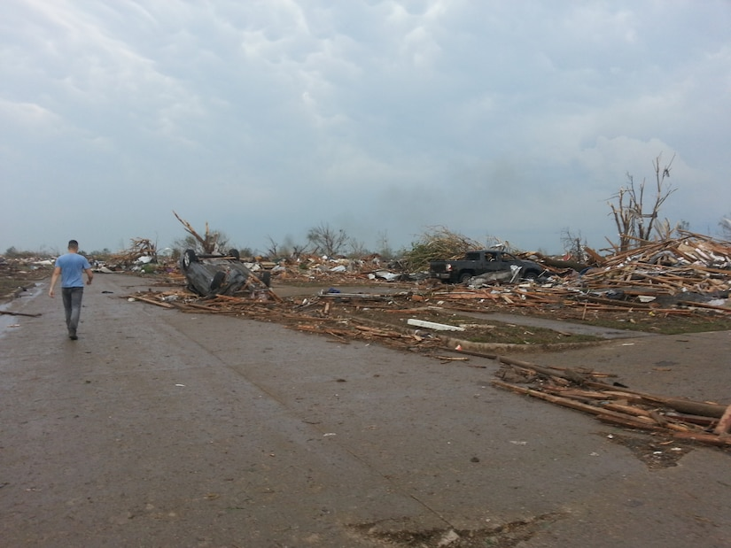 MOORE, Okla. -- A volunteer searches for survivors after an EF-4 tornado struck the area May 20, 2013.  (Courtesy photo)