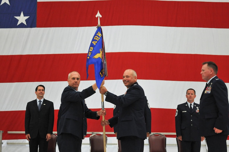 U.S. Air National Guard Col. Dan Yenchesky accepts the wing guidon from Brig. Gen. Gary Ebben, Assistant Adjutant General of Wisconsin, signifying the change of command and accepting the title of wing commander for the 128th Air Refueling Wing at the 128 ARW in Milwaukee, Wi, July 14, 2013. (U.S. Air National Guard photo by Staff Sgt. Jeremy Wilson/Released)