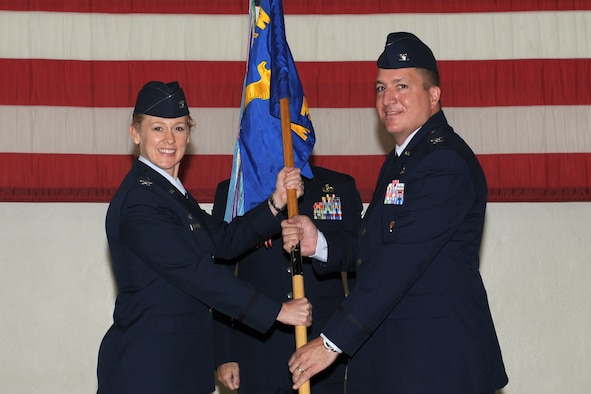 GOODFELLOW AIR FORCE BASE, Texas -- Col. Kimberlee Joos, 17th Training Wing Commander, passes the 17th Mission Support Group guidon to the incoming commander, Col. Dominic Bernardi III, during the Change of Command ceremony, July 15. The change of command ceremony is steeped in tradition and allows units to witness the formal command transfer from one officer to another.  (U.S. Air Force photo by Staff Sgt. Laura R. McFarlane)