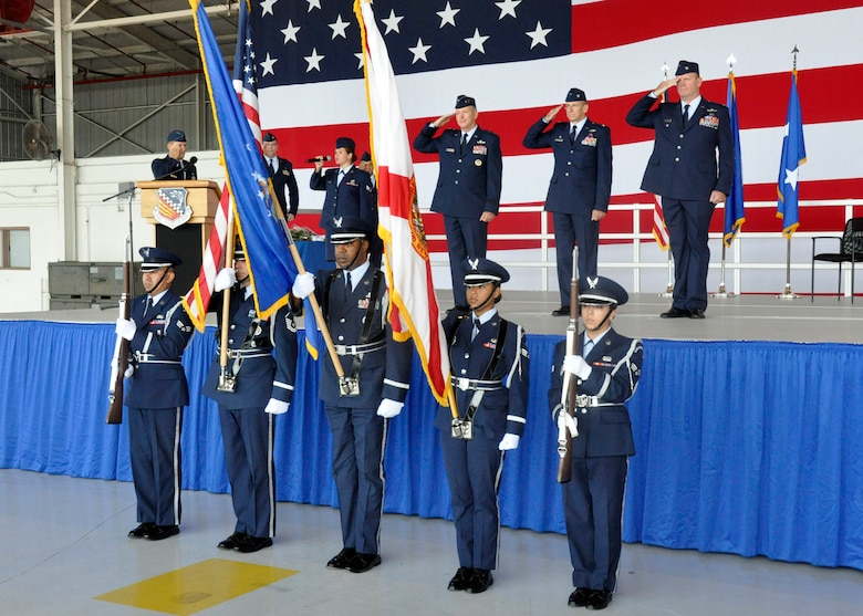 Maj. Gen. William B. Binger, 10th Air Force commander, Chief Master Sgt. Cameron Kirksey, Air Force Reserve Command command chief master sergeant, Col. Donald R. Lindberg, new 10th Air Force vice commander, and Col. Christian G. Funk, new 482nd Fighter Wing commander,  stand at attention as Senior Airman Jessica Herndon, 482nd Security Forces Squadron, sings the National Anthem with the Homestead Air Reserve Base Honor Guard presenting the colors during the 482nd FW change of command ceremony at Homestead Air Reserve Base, Fla., July 14. (U.S. Air Force photo/Senior Airman Nicholas Caceres)