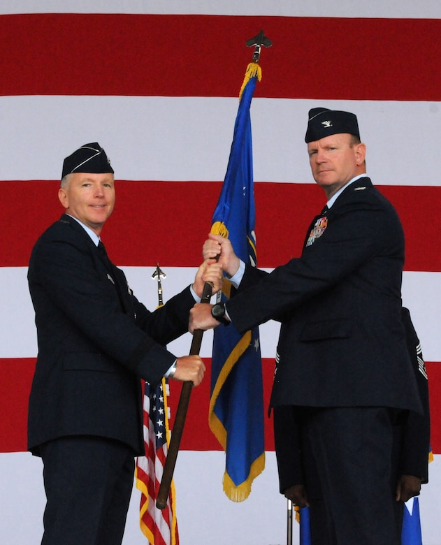 Maj. Gen. William B. Binger (left), 10th Air Force commander, passes the 482nd Fighter Wing guidon to Col. Christian G. Funk, new 482nd Fighter Wing commander, during the 482nd FW change of command ceremony at Homestead Air Reserve Base, Fla., July 14. (U.S. Air Force photo/Senior Airman Jaimi Upthegrove)