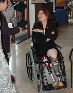 Tammy Duckworth, Illinois director of Veterans Affairs, speaks to community members before her presentation recognizing Disabilities Awareness Month in the Casablanca Room on Campbell Barracks in Heidelberg, Germany, Oct. 16.