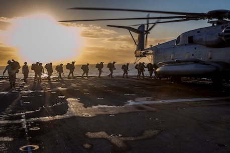 Marines and Sailors with Company E., Battalion Landing Team 2nd Battalion, 4th Marines, 31st Marine Expeditionary Unit, board a CH-53E Super Stallion helicopter from Marine Medium Tiltrotor Squadron 265 (Reinforced), 31st MEU, for a raid rehearsal as a part of Talisman Saber 2013, here, July 17. Talisman Saber 2013 is a biennial training activity aimed at improving Australian Defense Force and U.S. combat readiness and interoperability as a Combined Joint Task Force. The 31st MEU is the Marine Corps' force in readiness in the Asia-Pacific region and the only continuously deployed MEU. (Marine Corps photo by Cpl Codey Underwood)